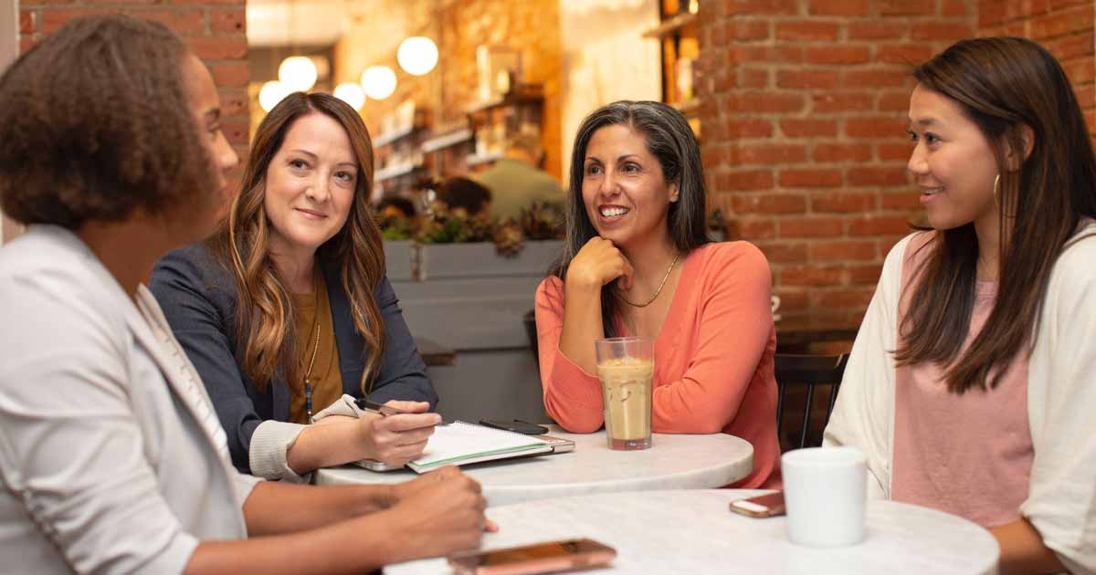 women chatting at cafe