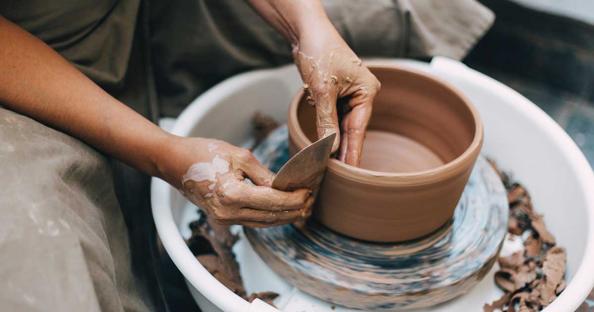 creating pottery on spinning wheel
